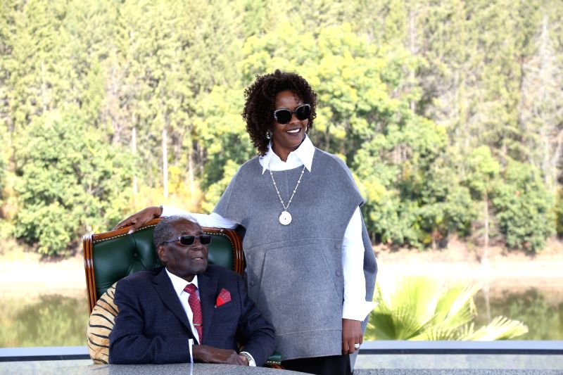 : Former Zimbabwean President Robert Mugabe(L) and his wife Grace Mugabe meet reporters after addressing in a press conference in his residence in Harare, Zimbabwe, ...