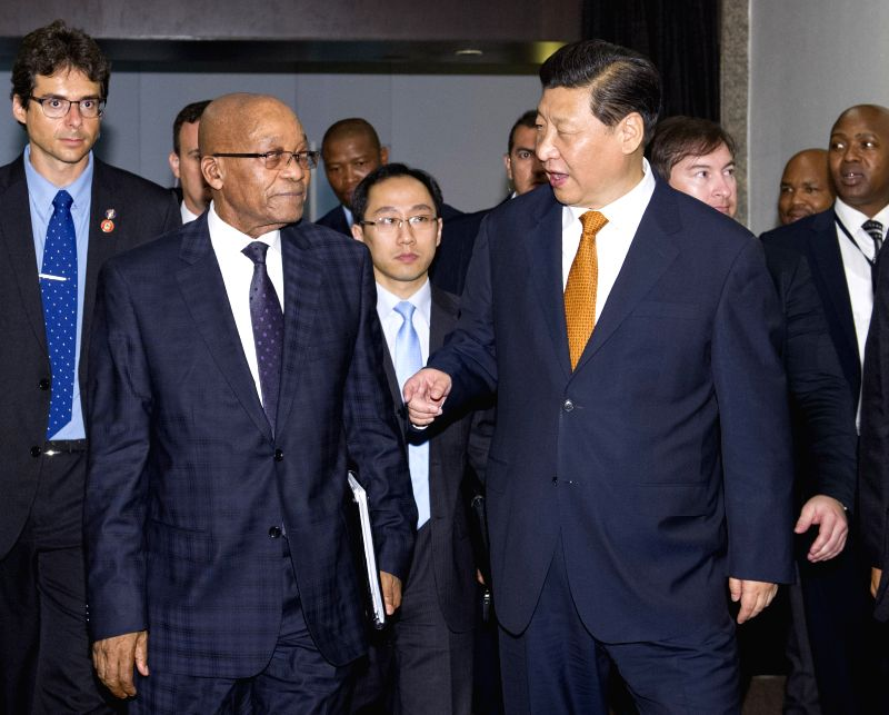 Chinese President Xi Jinping (R, front) meets with South African President Jacob Zuma (L, front) in Fortaleza, Brazil, July 14, 2014.