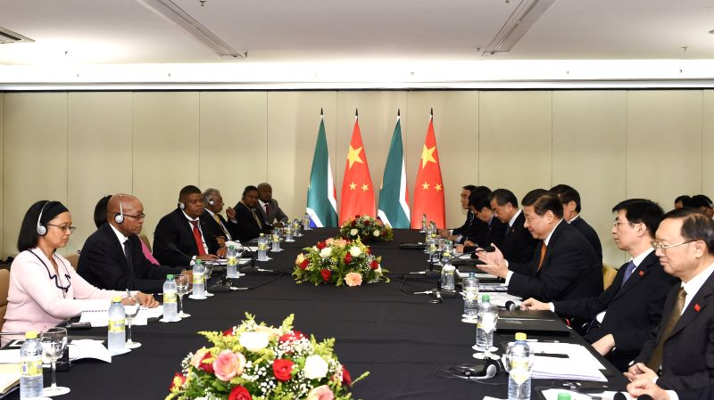 Chinese President Xi Jinping (3rd R) meets with South African President Jacob Zuma (2nd L) in Fortaleza, Brazil, July 14, 2014.