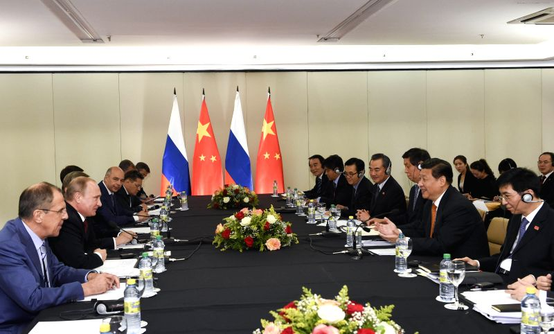 Chinese President Xi Jinping meets with Russian President Vladimir Putin in Fortaleza, Brazil, July 14, 2014.