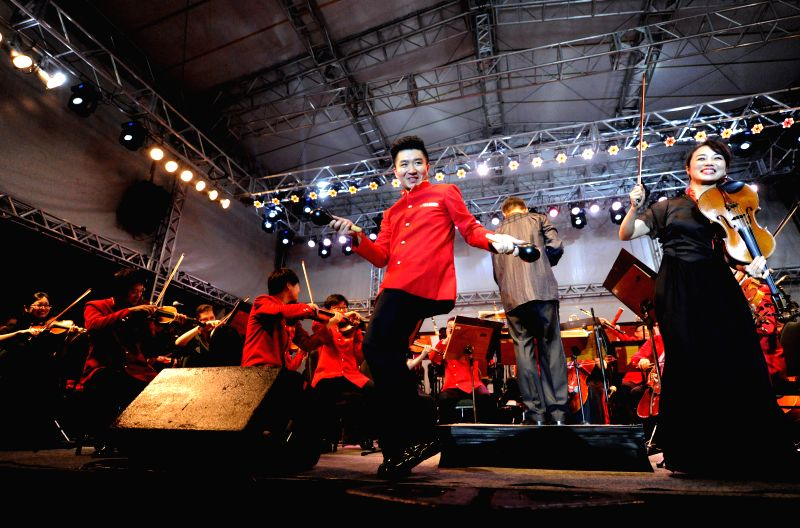 Actors Wang Yang (R, front) and Li Chenxiao (L, front) perform with the orchestra during a concert staged by Chinese Zhejiang Symphony Orchestra in Fortaleza, ... - Wang Yang