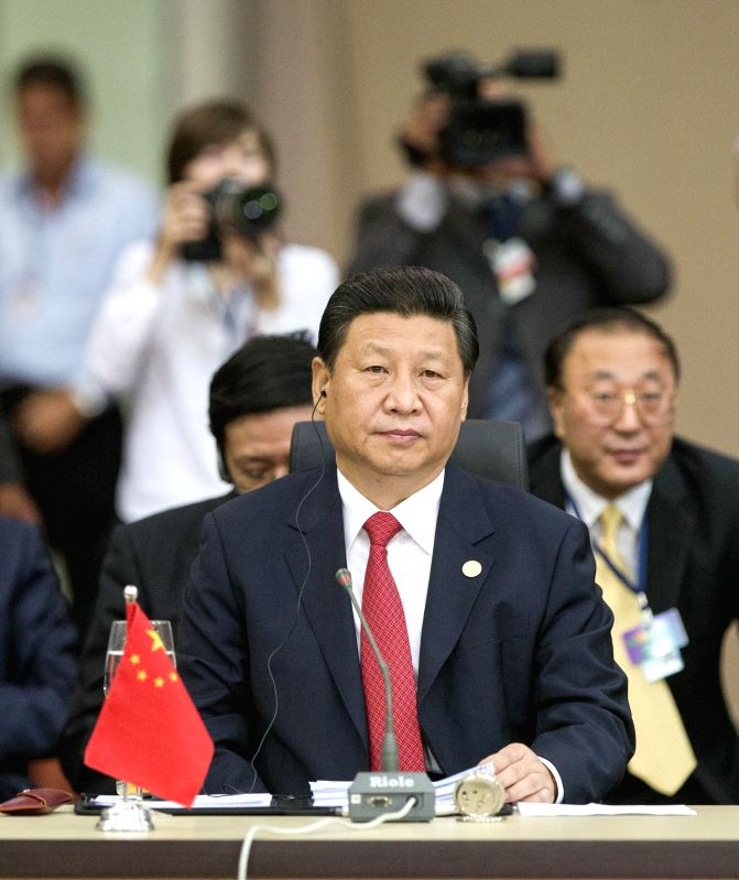Chinese President Xi Jinping (front) attends the sixth BRICS summit in Fortaleza, Brazil, July 15, 2014.
