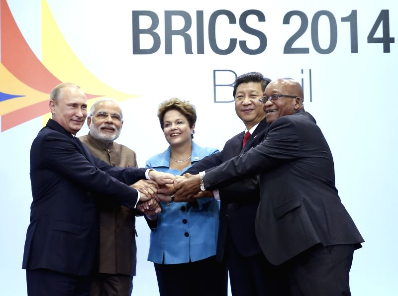 Chinese President Xi Jinping (2nd R) poses for a group photo with  Russian President Vladimir Putin (1st L), Indian Prime Minister Narendra Modi (2nd L), ... - Narendra Modi
