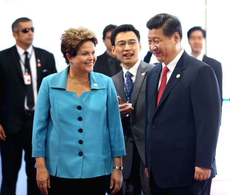 Chinese President Xi Jinping (R) is welcomed by Brazilian President Dilma Rousseff during the sixth BRICS summit in Fortaleza, Brazil, July 15, 2014. (Xinhua/Lan .