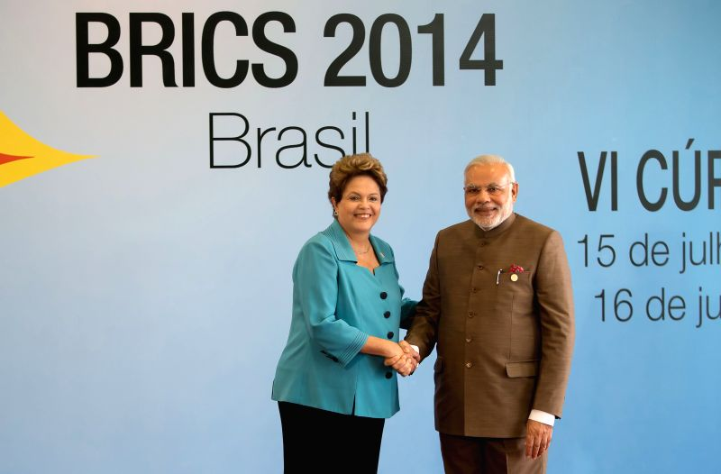 Indian Prime Minister Narendra Modi (R) is welcomed by Brazilian President Dilma Rousseff prior to the 6th BRICS Summit in Fortaleza, Brazil, July 15, 2014. ... - Narendra Modi