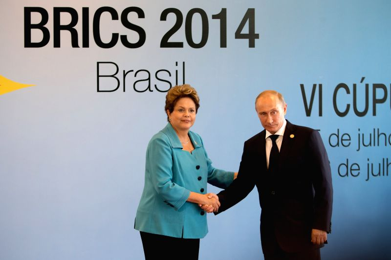 Russian President Vladimir Putin (R) is welcomed by Brazilian President Dilma Rousseff prior to the 6th BRICS Summit in Fortaleza, Brazil, July 15, 2014. ...