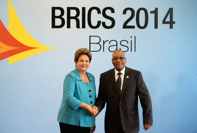 South African President Jacob Zuma (R) is welcomed by Brazilian President Dilma Rousseff prior to the 6th BRICS Summit in Fortaleza, Brazil, July 15, 2014. ...