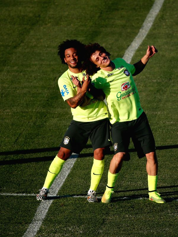 Brazil's Marcelo (L) and  David Luiz are seen in a training session in Fortaleza, Brazil, on July 3, 2014.