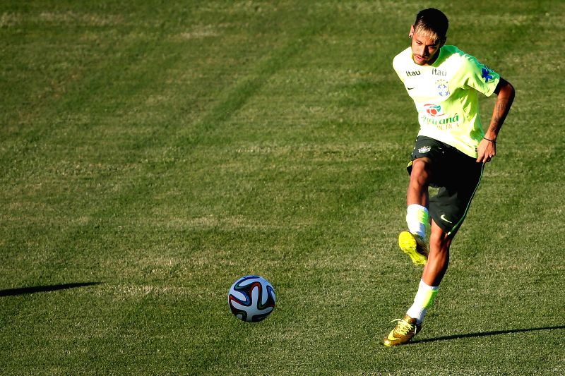Brazil's Neymar kicks a ball in a training session in Fortaleza, Brazil, on July 3, 2014.