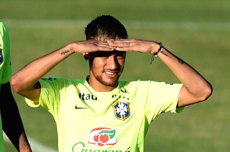 Brazil's Neymar looks on in a training session in Fortaleza, Brazil, on July 3, 2014.