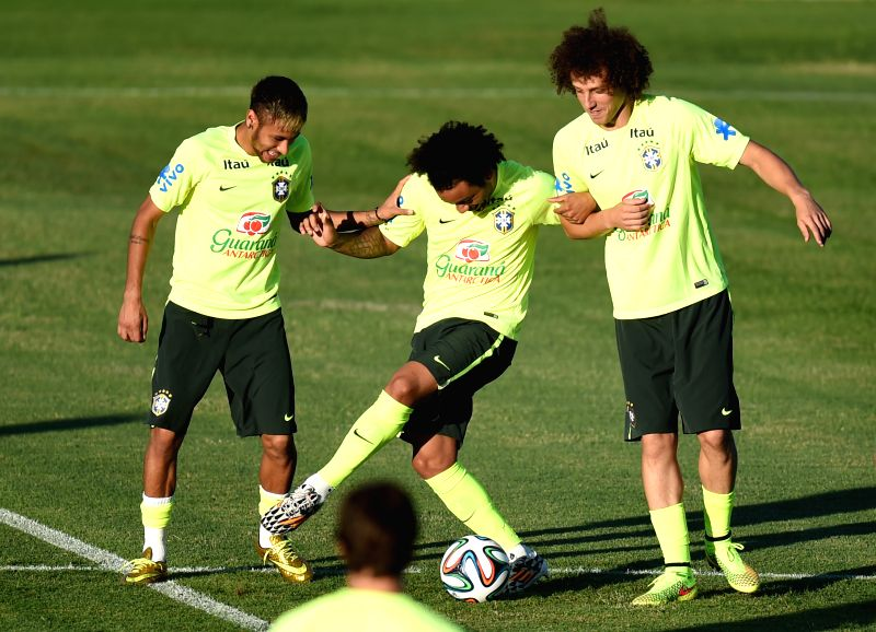 Brazil's Neymar (L), Marcelo (C) and David Luiz are seen in a training session in Fortaleza, Brazil, on July 3, 2014.