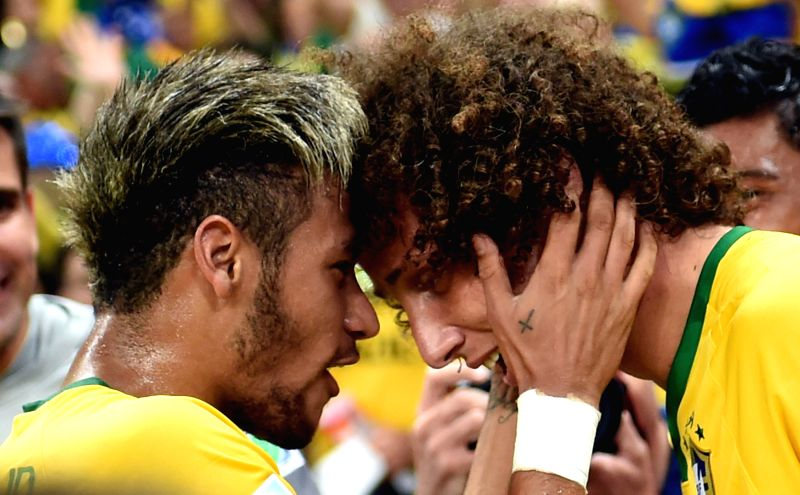 Brazil's David Luiz (R) celebrates his goal with Neymar during a quarter-finals match between Brazil and Colombia of 2014 FIFA World Cup at the Estadio Castelao ...