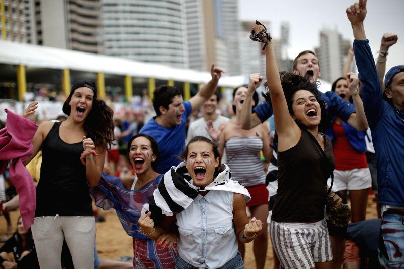 French fans react to a goal of France while watching a Group E match between France And Honduras of 2014 FIFA World Cup in Fortaleza, Brazil, June 15, 2014.