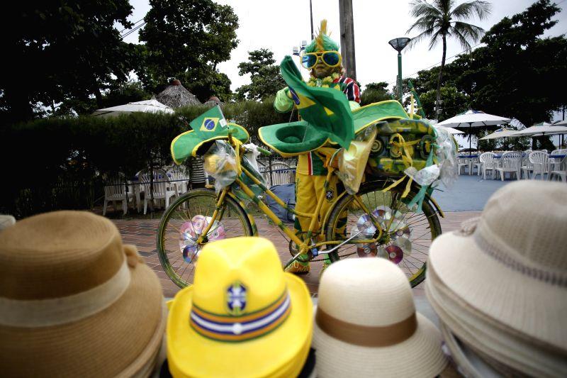 A vendor arranges his merchandise near the Iracema beach in the city of Fortaleza, Brazil, June 16, 2014.