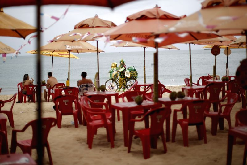 A vendor is seen selling souvenirs on the Iracema beach in the city of Fortaleza, Brazil, June 16, 2014.