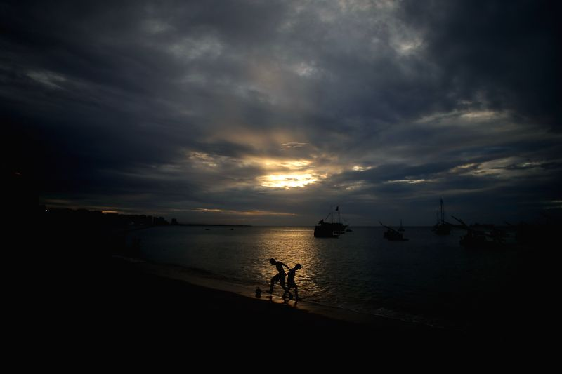 Kids play football at the Mucuripe beach in the city of Fortaleza, Brazil, June 16, 2014.
