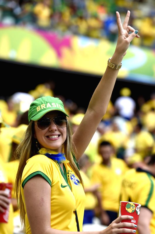 A fan of team Brazil cheers prior to a Group A match between Brazil and Mexico of 2014 FIFA World Cup at the Estadio Castelao Stadium in Fortaleza, Brazil, June ..