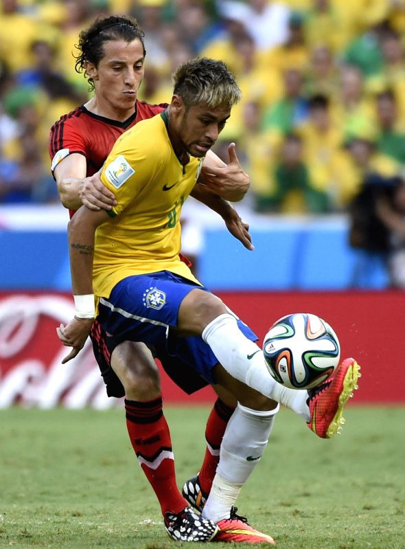 Brazil's Neymar (R) vies with Mexico's Andres Guardado (L) during a Group A match between Brazil and Mexico of 2014 FIFA World Cup at the Estadio Castelao Stadium