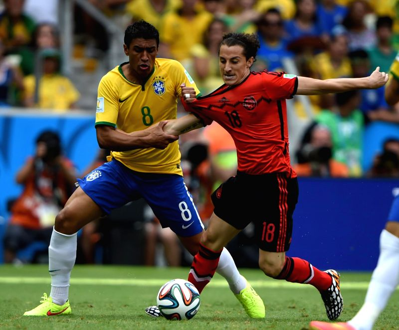 Brazil's Paulinho (L) vies with Mexico's Andres Guardado (R  during a Group A match between Brazil and Mexico of 2014 FIFA World Cup at the Estadio Castelao ...
