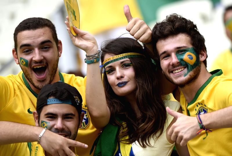 Fans of team Brazil cheer prior to a Group A match between Brazil and Mexico of 2014 FIFA World Cup at the Estadio Castelao Stadium in Fortaleza, Brazil, June 17,