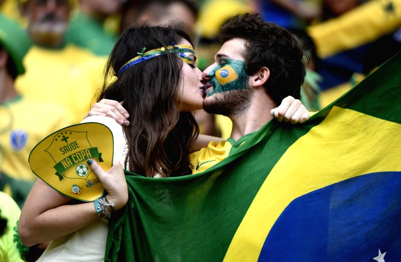 Fans of team Brazil kiss prior to a Group A match between Brazil and Mexico of 2014 FIFA World Cup at the Estadio Castelao Stadium in Fortaleza, Brazil, June 17, .
