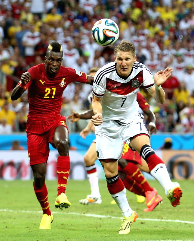 Bastian Schweinsteiger (R) of Germany heads the ball to shoot during a Group G match between Germany and Ghana of 2014 FIFA World Cup at the Estadio Castelao ...