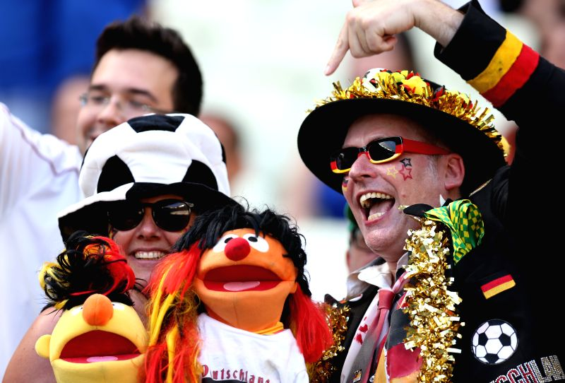 Fans of Germany cheer ahead of a Group G match between Germany and Ghana of 2014 FIFA World Cup at the Estadio Castelao Stadium in Fortaleza, Brazil, June 21, ...