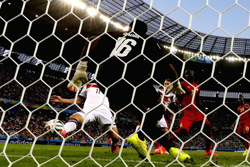 Germany's Miroslav Klose (L) shoots a goal during a Group G match between Germany and Ghana of 2014 FIFA World Cup at the Estadio Castelao Stadium in Fortaleza, ..