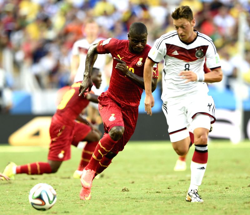 Mesut Ozil (R) of Germany runs with the ball during a Group G match between Germany and Ghana of 2014 FIFA World Cup at the Estadio Castelao Stadium in Fortaleza,