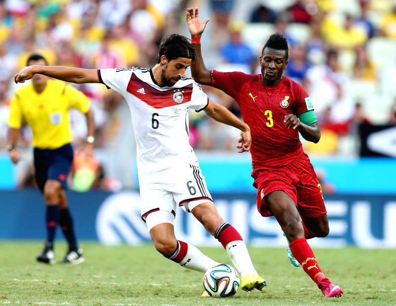 Sami Khedira(L) of Germany vies with Asamoah Gyan of Ghana during a Group G match between Germany and Ghana of 2014 FIFA World Cup at the Estadio Castelao Stadium