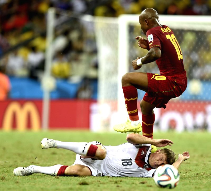 Toni Kroos (Bottom) of Germany vies with Andre Ayew of Ghana during a Group G match between Germany and Ghana of 2014 FIFA World Cup at the Estadio Castelao ...