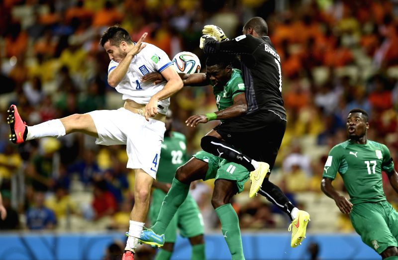 (Cote d'Ivoire's goalkeeper Boubacar Barry (1st R, top) blocks the ball during a Group C match between Greece and Cote d'Ivoire of 2014 FIFA World Cup at the ...