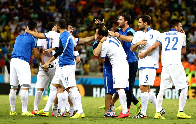 (Greece's celebrate after winning a Group C match between Greece and Cote d'Ivoire of 2014 FIFA World Cup at the Estadio Castelao Stadium in Fortaleza, Brazil, ...