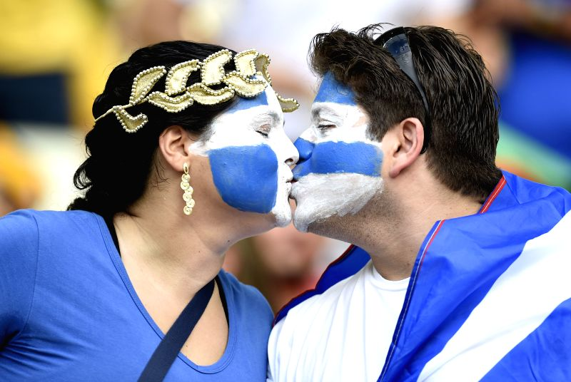 (Greece's fans kiss prior to a Group C match between Greece and Cote d'Ivoire of 2014 FIFA World Cup at the Estadio Castelao Stadium in Fortaleza, Brazil, June ...