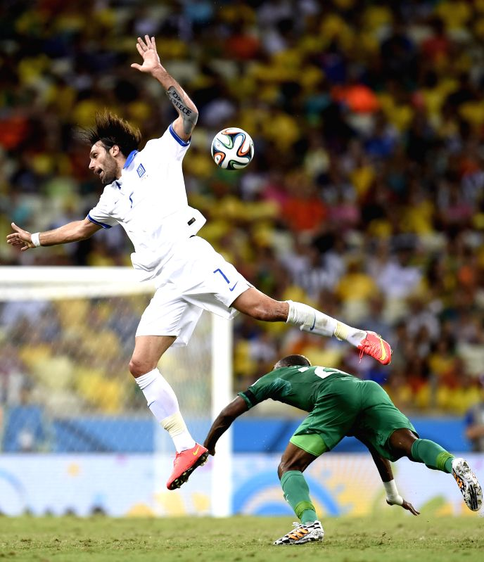 (Greece's Giorgios Samaras (L) vies with Cote d'Ivoire's Geoffroy Serey Die during a Group C match between Greece and Cote d'Ivoire of 2014 FIFA World Cup at the .