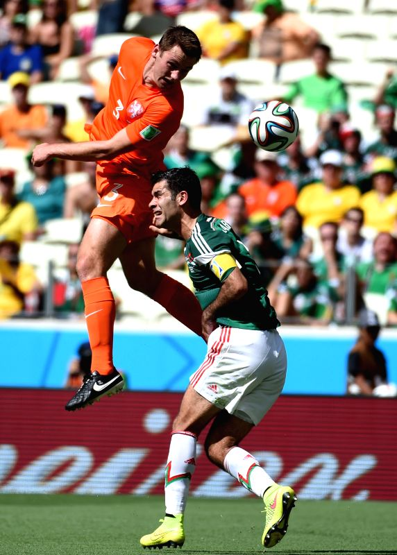 Netherlands's Stefan de Vrij (top) competes for a header during a Round of 16 match between Netherlands and Mexico of 2014 FIFA World Cup at the Estadio Castelao .