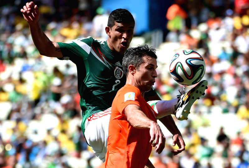 Netherlands's Robin van Persie (bottom) vies with Mexico's Francisco Rodriguez during a Round of 16 match between Netherlands and Mexico of 2014 FIFA World Cup at