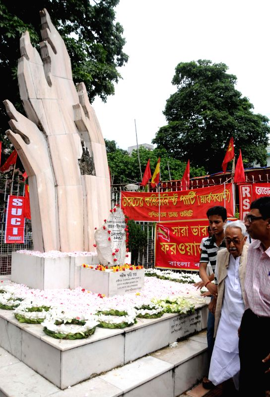 Forward Bloc Ashok Ghosh after paying tribute to the martyrs on `Shahid Divas` in Kolkata on Aug 31, 2014. - Bloc Ashok Ghosh