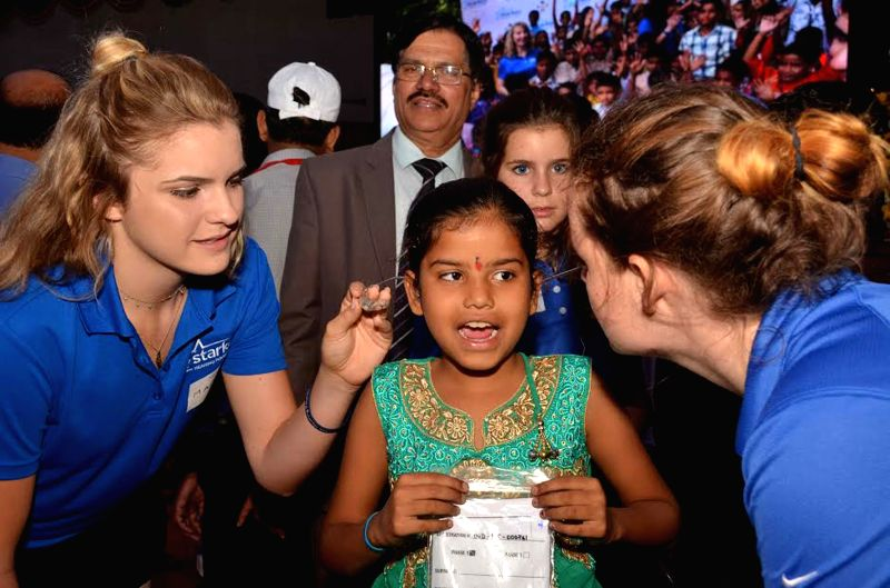 Founder and CEO, Starkey Hearing Foundation (USA) William F Austin with the members of Red Cross Society distribute BTE hearing Aids to deaf children across the state during a programme ...