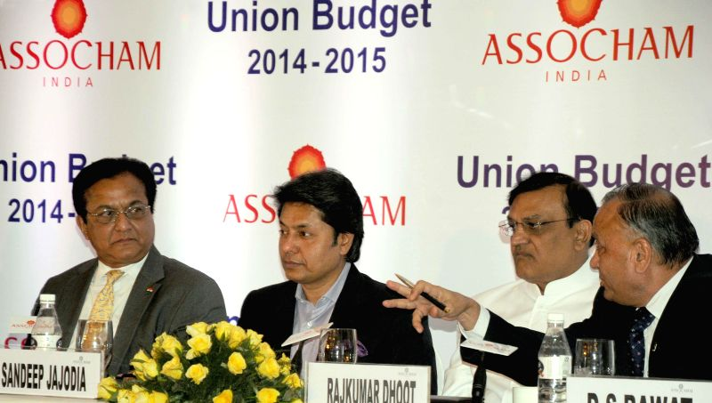 Founder and president of ASSOCHAM Rana Kapoor, Vice President  Sandeep Jajodia and ASSOCHAM secretary general, Mr D.S. Rawat during ASSOCHAM Interactive Session on General Budget 2014-15 in New Delhi - Kapoor