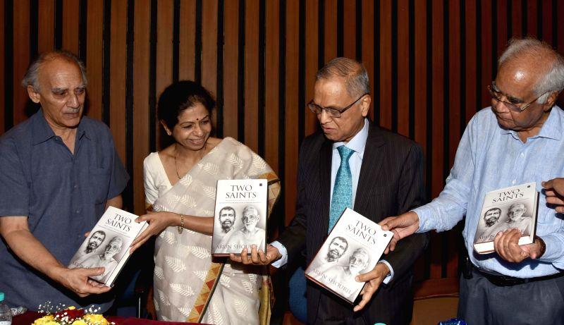"Founder Chairman of Infosys N R Narayana Murthy, Dr Vijayalakshmi Ravindranath, veteran Journalist Arun Shourie and scientist Baldev Raj during the launch of Shourie's book ""Two ..."