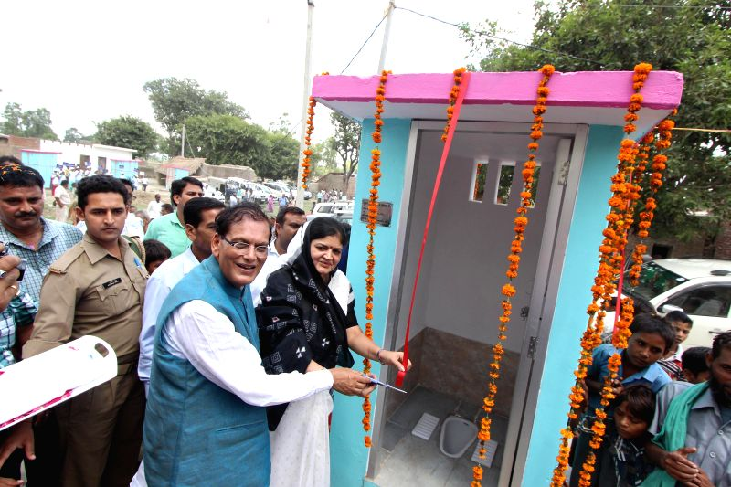 Founder of Sulabh International Dr. Bindeshwar Pathak hands over a toilet built by the organisation at Katra Sadatganj village of Uttar Pradesh's Budaun district to the people on Aug 31, 2014. Two ... - Bindeshwar Pathak