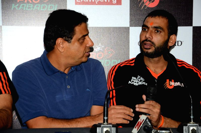 Founder of UTV group and owner of U Mumba Kabaddi team Ronnie Screwvala and U Mumba captain Anup Kumar during the press conference as a preview to the seventh leg of Star Sports Pro Kabaddi ... - Anup Kumar