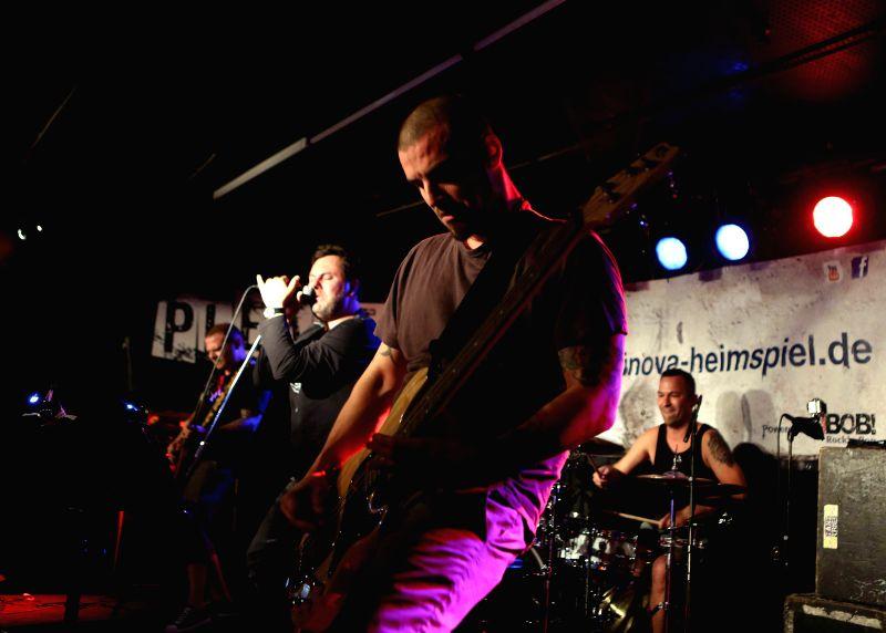 """Members of """"PLEASE"""" perform in Nachtleben in Frankfurt, Germany on Aug. 1, 2014."""