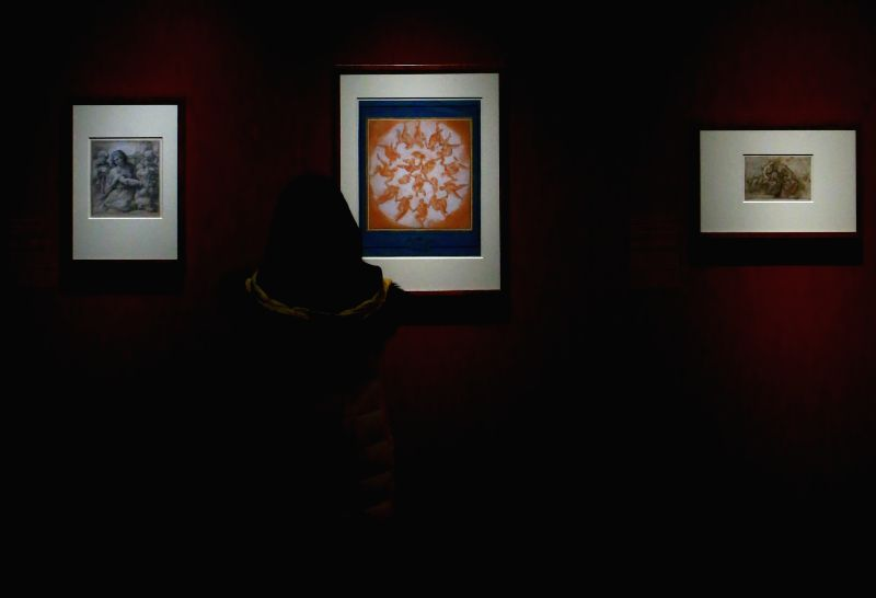 "A visitor enjoys art works at the exhibition ""Raffael to Titian"" at the Staedel Museum in Frankfurt, Germany, on Dec.23, 2014. The exhibition is held ..."