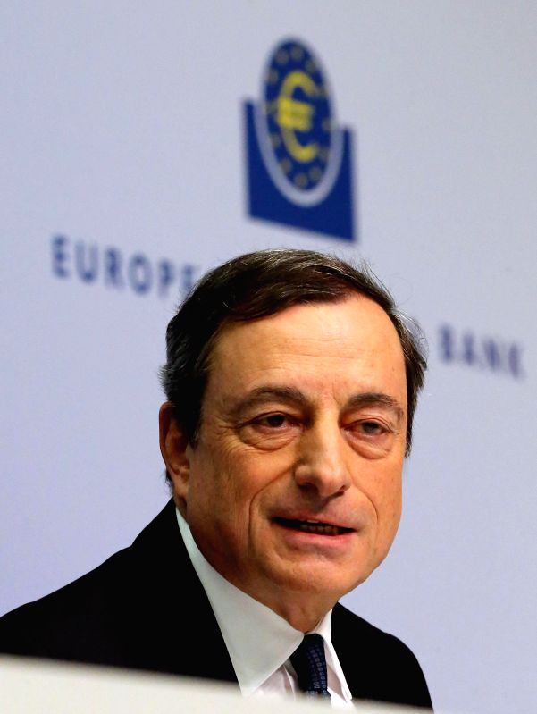 Frankfurt (Germany): European Central Bank (ECB) President Mario Draghi addresses at a news conference in the ECB's new headquarters in Frankfurt, on Dec. 4, 2014. Draghi said the bank would reassess