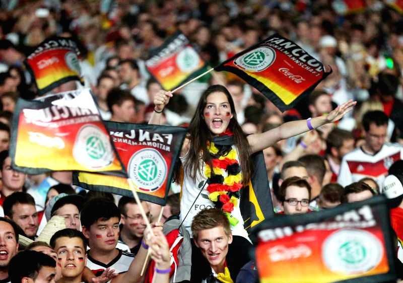 FRANKFURT, July 1, German football fans react as they watch the 2014 World Cup round of 16 soccer match between Germany and Algeria at a public viewing event in Frankfurt, Germany, June ..