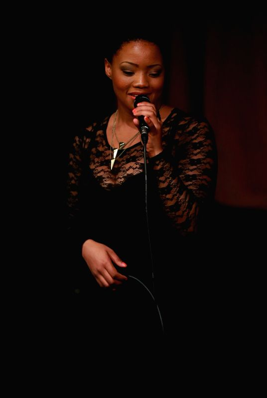 Adora Lilani Kisting, a member of the cappella group VMSIX from Namibia, performs at the International Theater in Frankfurt, Germany, on June 27, 2014. VMSIX ...