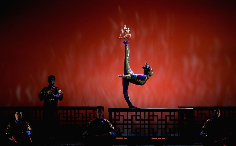 """Chinese acrobats perform in an acrobatic show titled """"The Forbidden City"""" at the Old Opera House in Frankfurt, Germany on March 10, 2015.  (Xinhua/Luo ..."""
