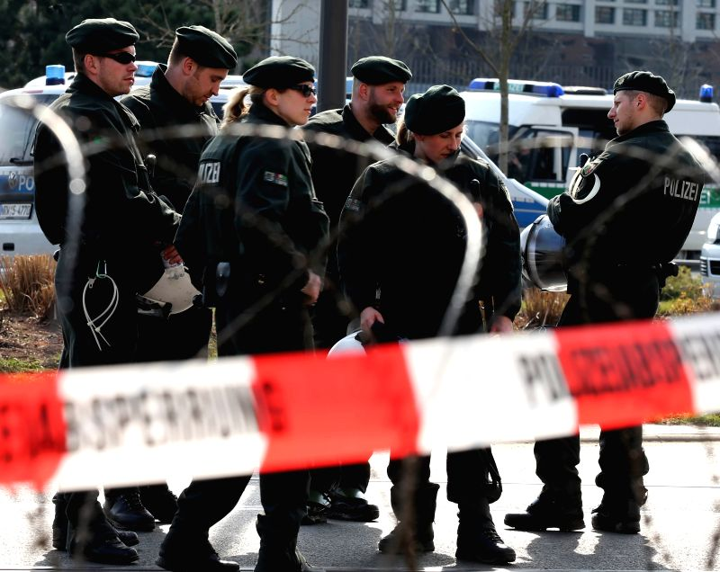 Police blockades the traffic near the new office building of the European Central Bank (ECB) in Frankfurt, Germany, on March 18, 2015. At least 88 policemen were ...